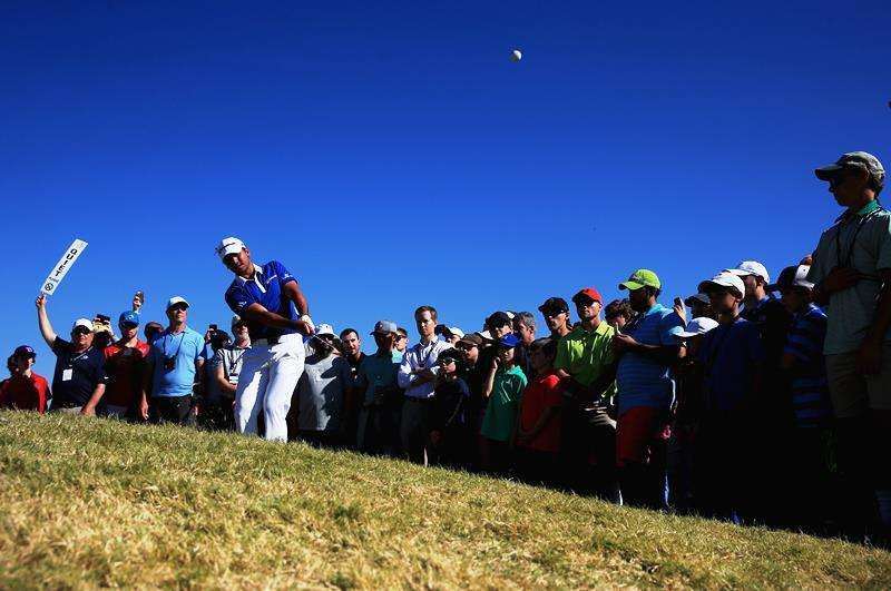 On target: Jason Day hits a pitch shot on the 12th hole of the final at the Dell Match Play (photo by Getty Images)