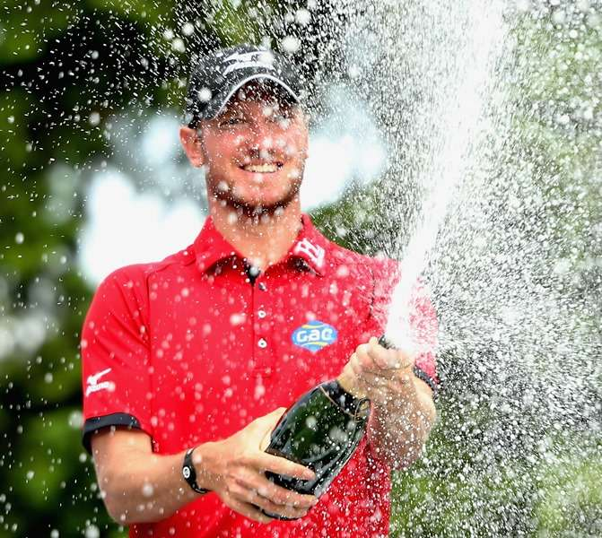 Champagne moment: Chris Wood celebrates victory at Wentworth (photo by Getty Images)