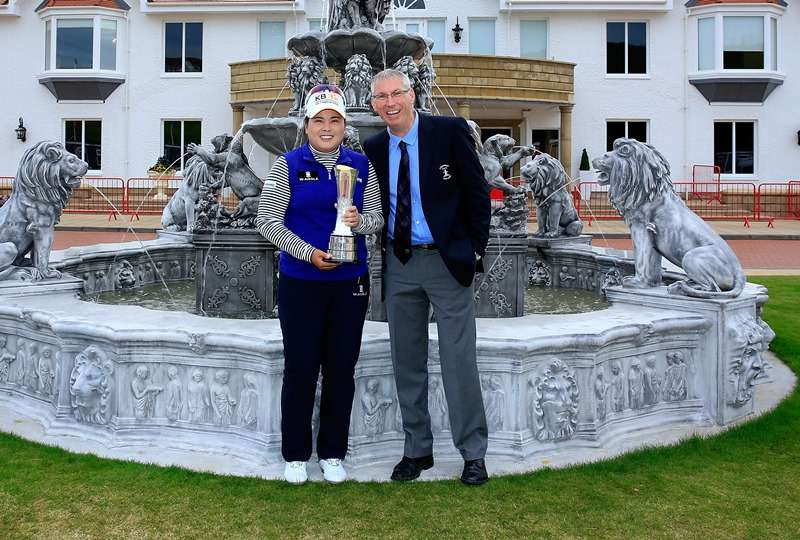 Great honour: Inbee Park, of South Korea, shows off the Women's British Open trophy with Ricky Hall, the director of golf at Turnberry (photo by Getty Images)