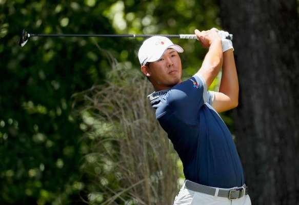 Kim surges clear with round of 60