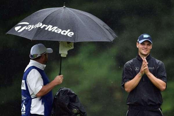 Rain sets up marathon Sunday in final Major