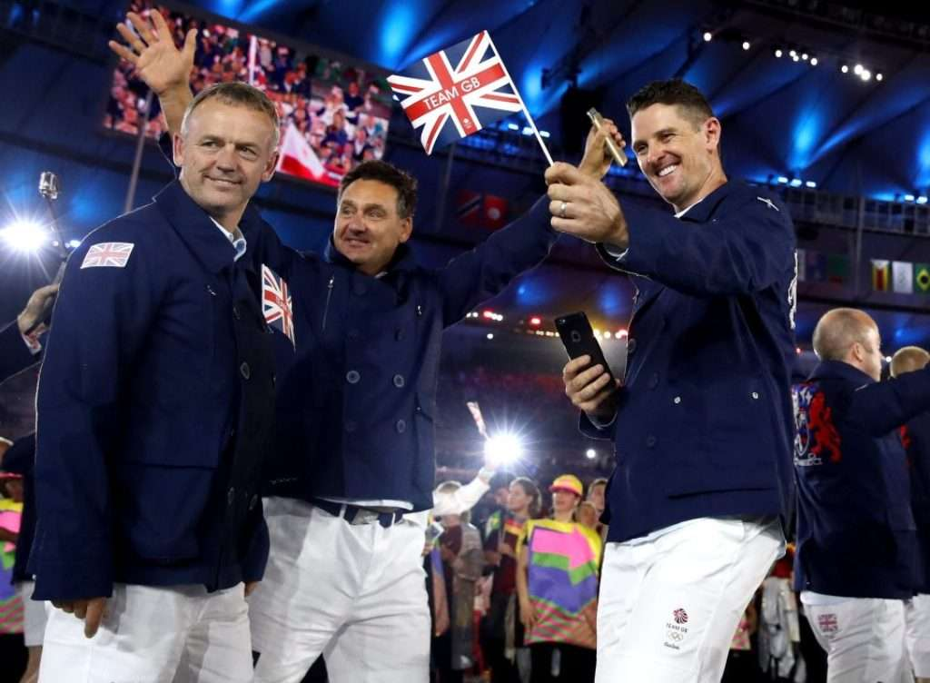 Ceremonial start: Justin Rose, right, caddie Mark Futcher and team manager Jamie Spence, left, enjoy the opening to the games