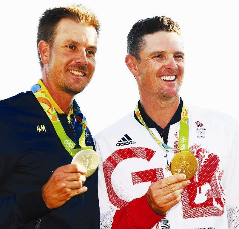 (Picture by Getty Images) Smiles better: Stenson and Rose had their own version of the duel in the sun