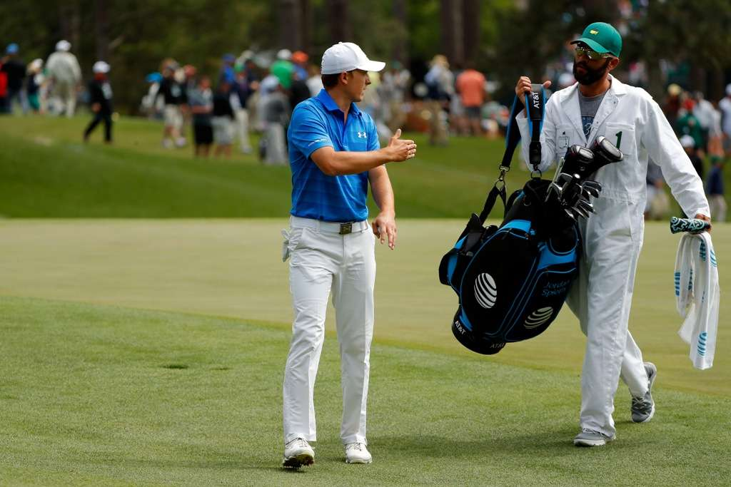 Painstaking: Jordan Spieth and his caddie Michael Greller discuss club selection