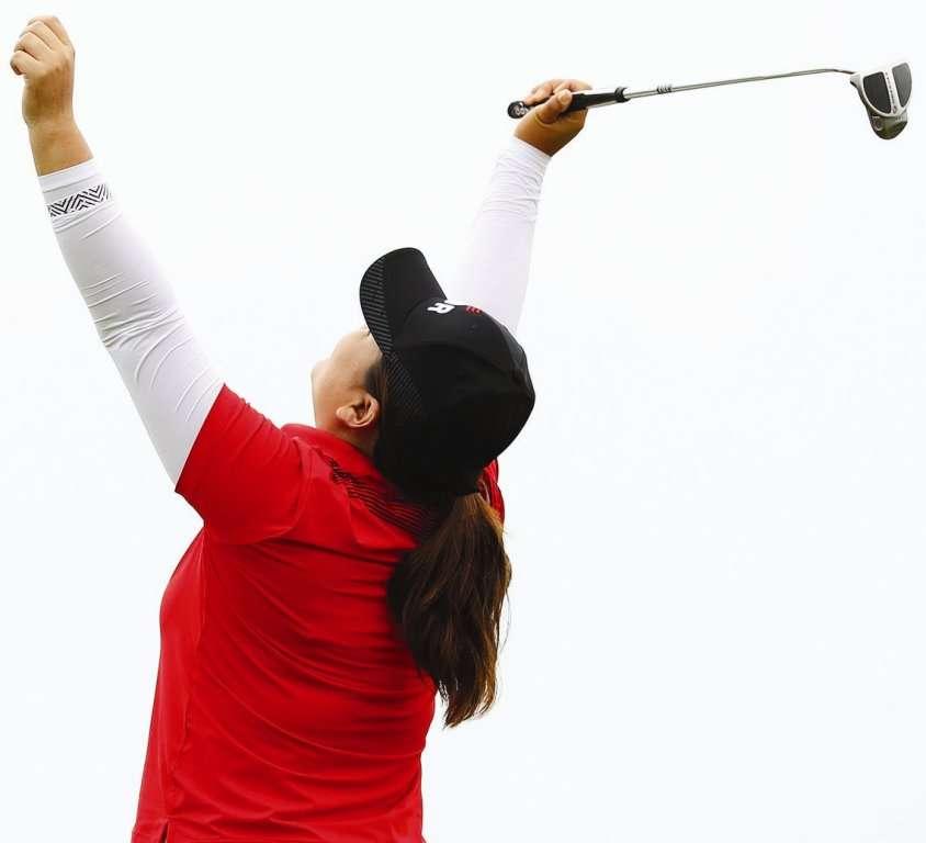 It's gold! Inbee Park celebrates her win