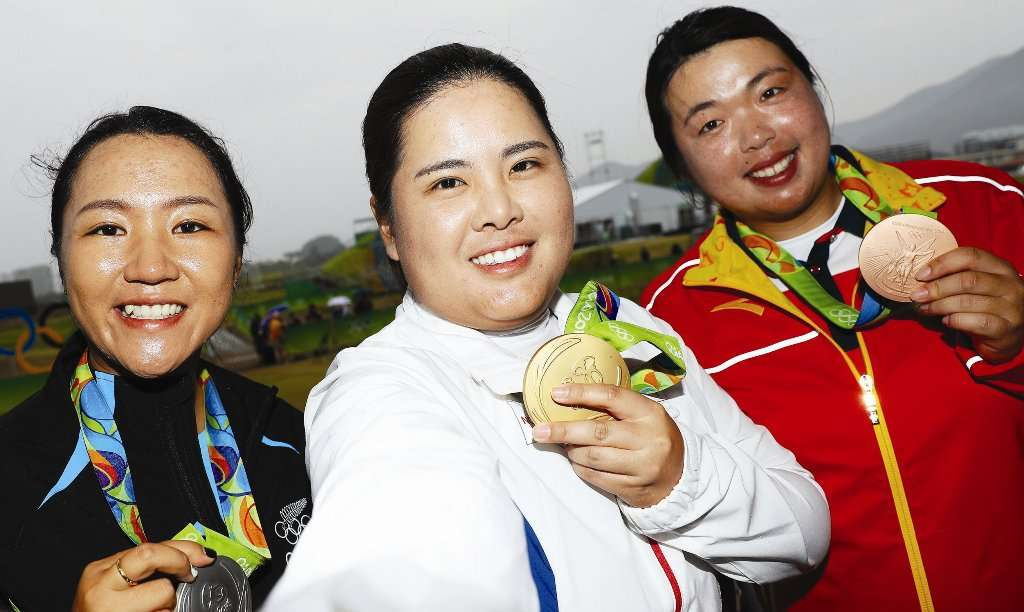 (Photo by Getty Images) Top trio: Silver medalist, Lydio Ko of New Zealand, left. with gold medalist, Inbee Park, of Korea, and brozne medalist Shanshan Feng, of China