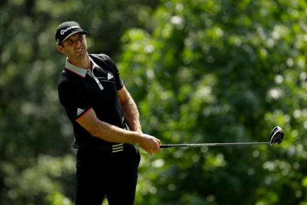 Johnson surges in to lead share