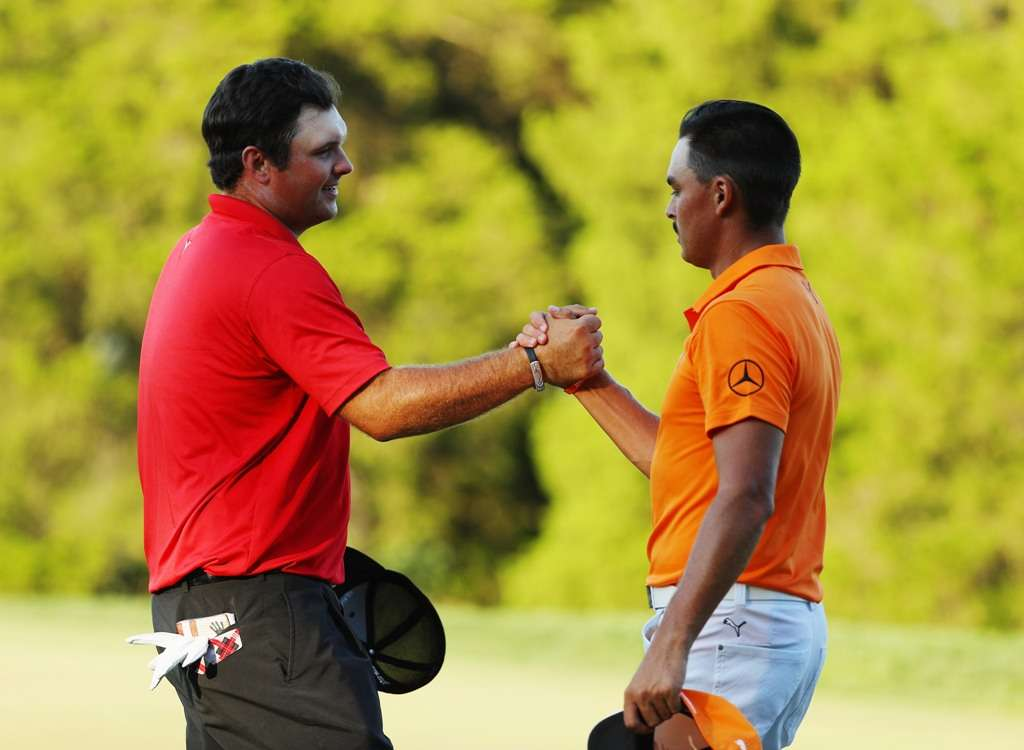 Best wishes: Patrick Reed, left, says that he is confident Rickie Fowler will earn his place (Photo by Getty Images)
