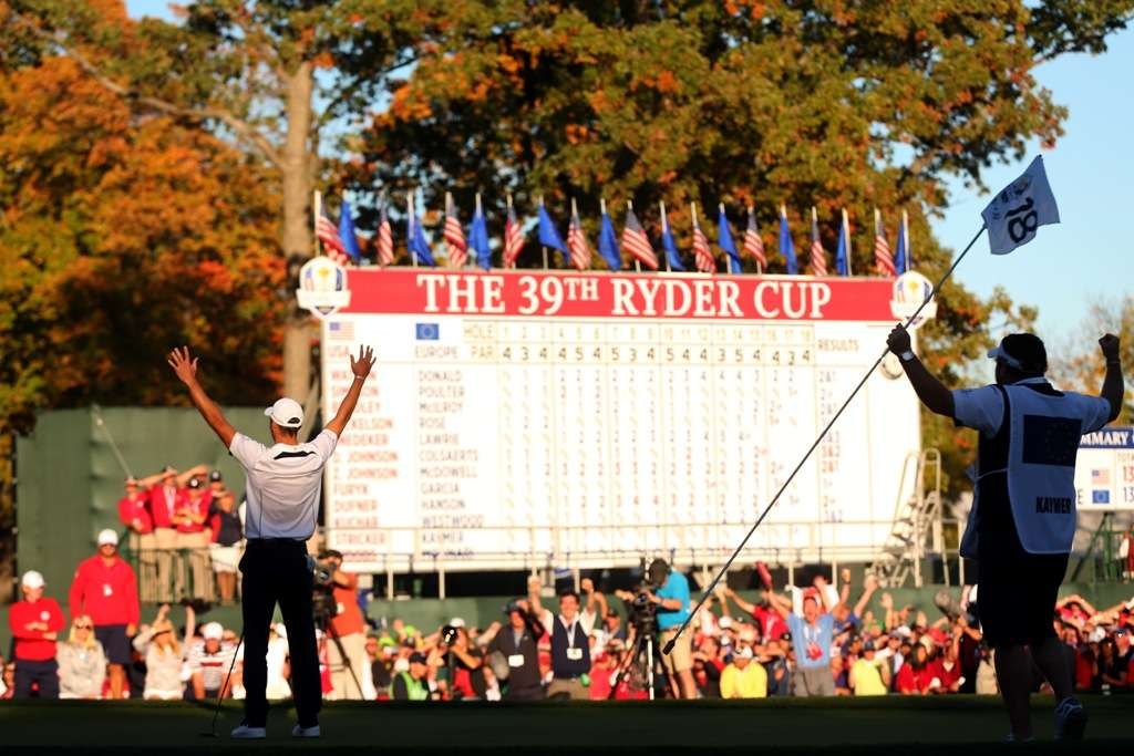 Done it: German Martin Kaymer raises his arms after sinking the putt to win the 2012 Ryder Cup, while his caddy Craig Connelly watches with jubilation (Photo by Getty Images)